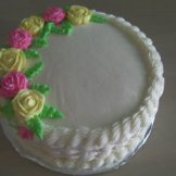 Simple Very Vanilla Cake with Snowy Vanilla Buttercream icing. Basketweave pattern on the sides. Your personalized message completes this cake.
