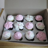 Pink and white cupcakes to co-ordinate with cake for a baby shower