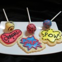 Super Hero colours on cake pops and cookies round out the theme of this party.