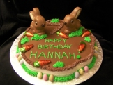 Delicious chocolate bunnies adorn the top of this chocolate gluten-free cake. This would be a cute choice for an Easter cake, too.