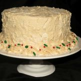Elegant Holly Gingerbread cake with cinnamon cream cheese icing