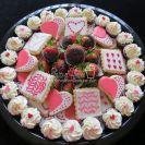 Sugar cookies, chocolate dipped strawberries, red velvet mini cupcakes